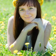 Stock Photo: Woman relaxing outdoor in dandelion