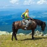 Rider on horseback at mountains — Stock Photo #9890512