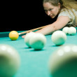 Woman aiming for billiard table — Stock Photo