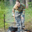 Royalty-Free Stock Photo: Tourist cooking meal in kettle
