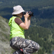 Nature Photographer taking pictures — Stock Photo #9890536
