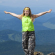 Happy woman standing  mountain peak — Stock Photo