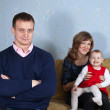 Happy parents with  child in home - Foto Stock