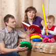 Parents with child in home — Stock Photo