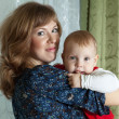 Mother with child  in home - Stockfoto