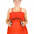 Pregnant woman with headphones — Stock Photo