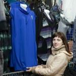 Woman chooses dress — Stock Photo #9891061