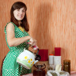 Woman brews herbs in teapot - Foto Stock