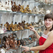 Royalty-Free Stock Photo: Tourist  chooses souvenir  in egyptian shop