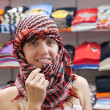 Woman  in egyptian clothes shop — Stock Photo