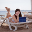 Woman  with laptop at resort — Stock Photo