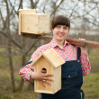 Woman with two  birdhouses — Stock Photo
