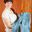 Woman shows   jeans beaded by herself - Foto Stock