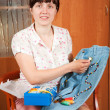Woman decorating cloth - Foto Stock