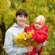 Happy mother with baby in autumn — Stock Photo #9891402