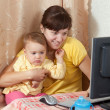 Woman with  baby working  with computer - Foto Stock