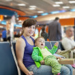 Mother and  child at airport — Photo