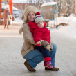 Happy mother with toddler  in winter — Stock Photo #9891556
