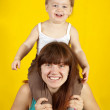 Mother with  child  over yellow — Photo