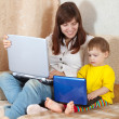Stock Photo: Happy womwith toddler using laptops
