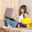 Happy mother and child with laptops — Stock Photo