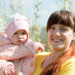 Stock Photo: Mother with baby girl in spring