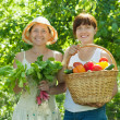 Two happy women with vegetables — Stock Photo