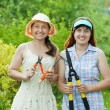 Two women with garden tools — Stock Photo