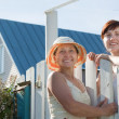 Stock Photo: Two women near fence wicket