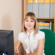 Businesswoman working in office room — Stock Photo #9891752