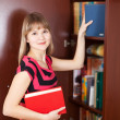 Woman selecting book — Stock Photo