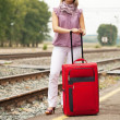 Woman with luggage waiting  train — Stock Photo