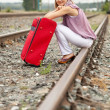 Woman   sitting on rail — Stock Photo