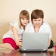 Two young women  with laptop — Stok fotoğraf