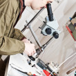 Jeweller is working with microscope — Stock Photo