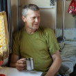 Man in sleeper train — Stockfoto