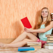 Smiling woman with books — Stock Photo