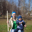 Woman with her son planting tree — Stockfoto #9892342