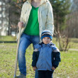 Woman and boy  with spade  in garden — Foto Stock