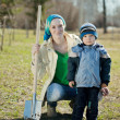 Woman and boy  with spade — Foto Stock