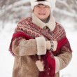 Stock Photo: Mature woman with kerchief in winter