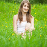 Teen girl in grass — Stock Photo #9892645