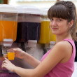 Girl pours  a juice - Stockfoto