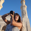 Travel photographer with digital camera - Stockfoto