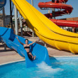 Girl in  water slide at aquapark — Stock Photo