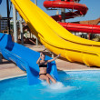 Girl sliding at aquapark — Stock Photo