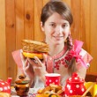 Stock Photo: Girl in traditional clothes with pancake
