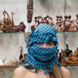 Woman  in egyptian  souvenirs shop - Foto Stock