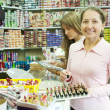 Two women chooses cosmetic — Stock Photo