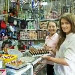 Two women buying lipstick — Stock Photo